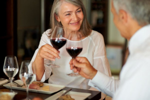 Older couple having wine